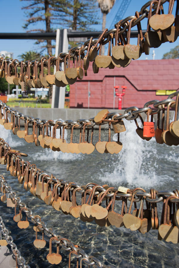 Love Lock Fence at the Swan Bell Tower. PERTH,WA,AUSTRALIA-NOVEMBER 17,2016: Love lock fence with golden heart-shaped padlocks outside the Swan Bell Tower in stock image