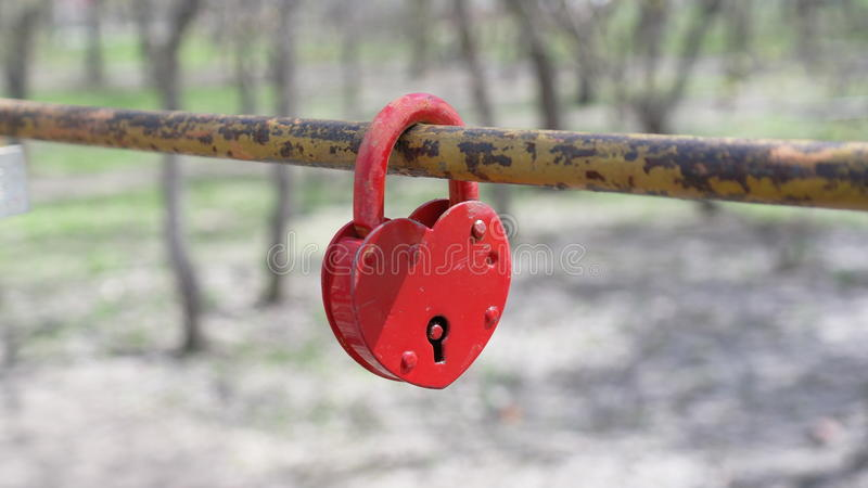 Love lock. Old love lock on the bridge in the city park stock image
