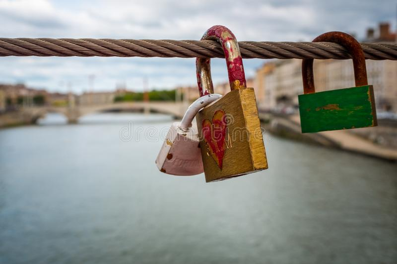A love lock over the Saone river, Lyon, France. A love lock over the Saone river, taken on a bridge crossing the river with another green look aside. Taken on an stock photo