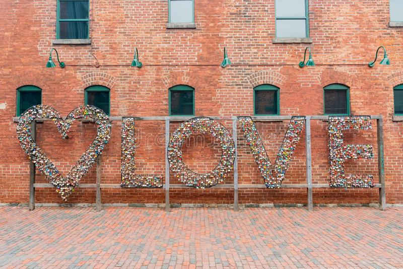 Love lock wall in The Distillery Historic District. Toronto, OCT 5: Love lock wall in The Distillery Historic District on OCT 5, 2018 at Tornoto, Canada royalty free stock photos