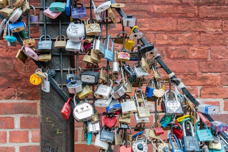 Love lock wall in The Distillery Historic District. Toronto, OCT 5: Love lock wall in The Distillery Historic District on OCT 5, 2018 at Tornoto, Canada royalty free stock image