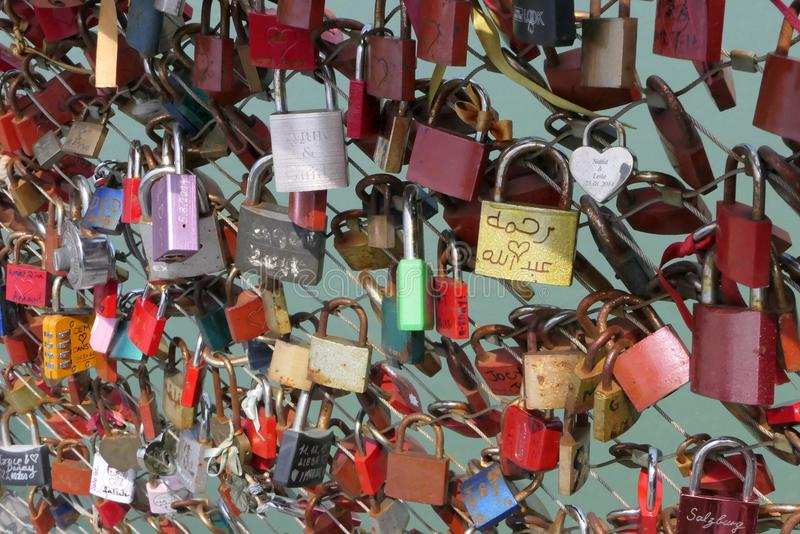 Love Locks on a Bridge Crossing the Salzach River in Salzburg stock images