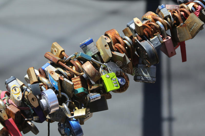 Love locks at the Brooklyn Bridge in New York. BROOKLYN, NEW YORK - AUGUST 13, 2017: Love locks at the Brooklyn Bridge in New York. Ritual of affixing padlocks royalty free stock image