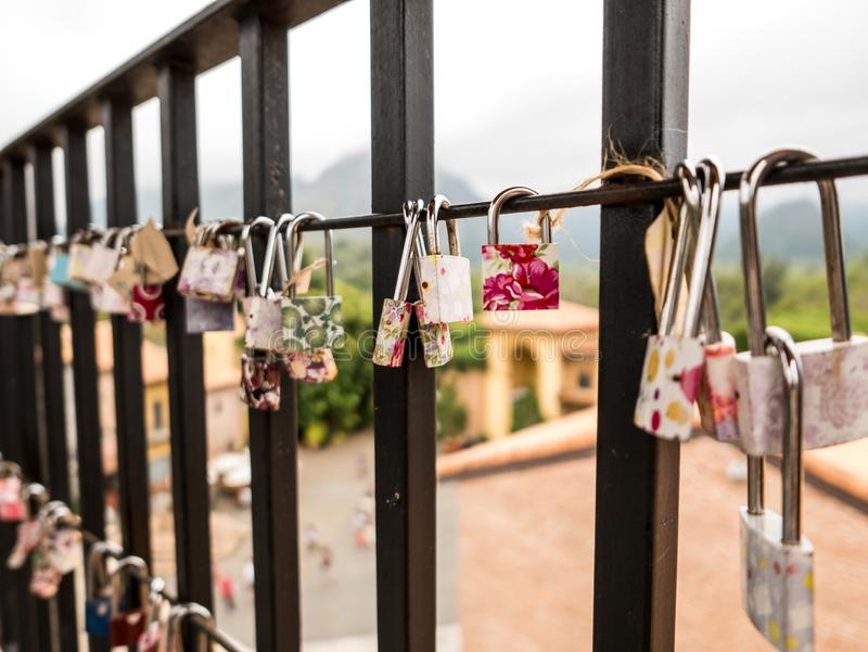 Love locks hanging on a lookout tower royalty free stock image