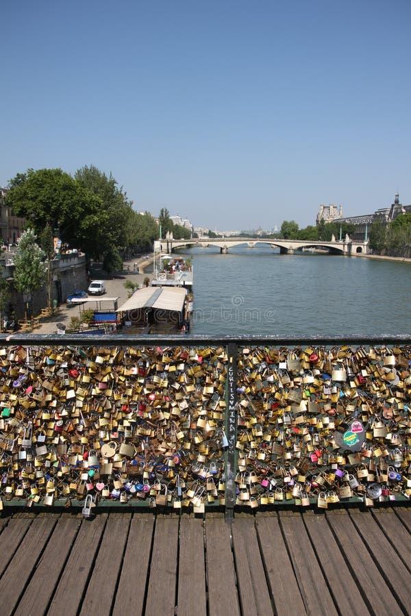 `love locks` on the Pont des Arts on the River Seine in Paris.  stock photo