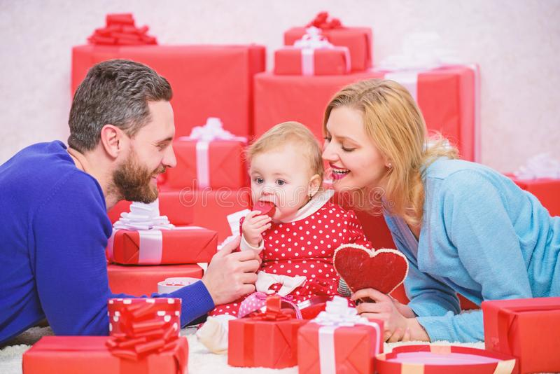 This is love. Love and trust in family. Bearded man and woman with little girl. Valentines day. Red boxes. Shopping royalty free stock photography