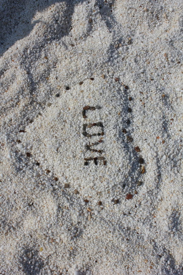 Love on marble beach royalty free stock photography