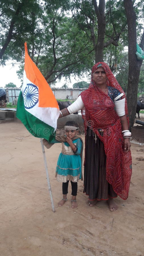 Love may India. Farmar family joint the national flag royalty free stock image