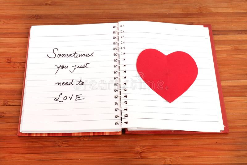 Love message. Beautiful shot of love message on diary page royalty free stock photo