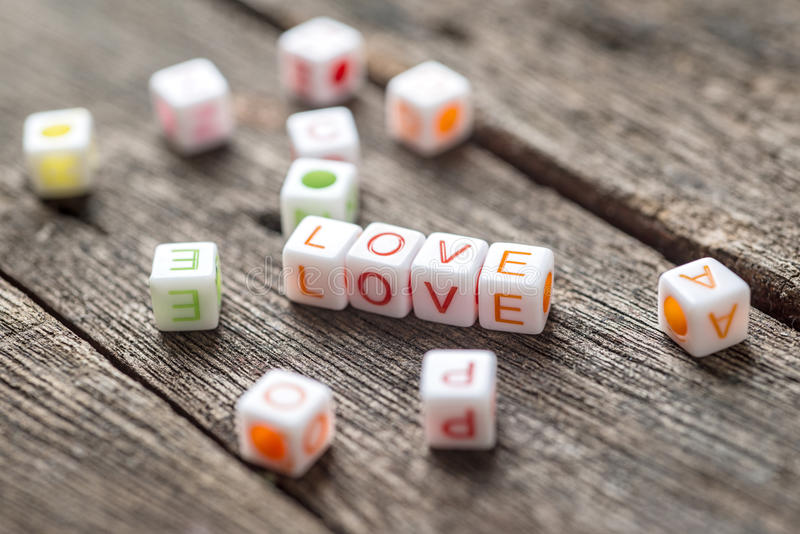 Love message written in blocks. Wooden Background,Selective focus royalty free stock images