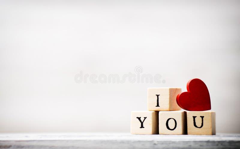 Love. Love message written in wooden blocks stock photo