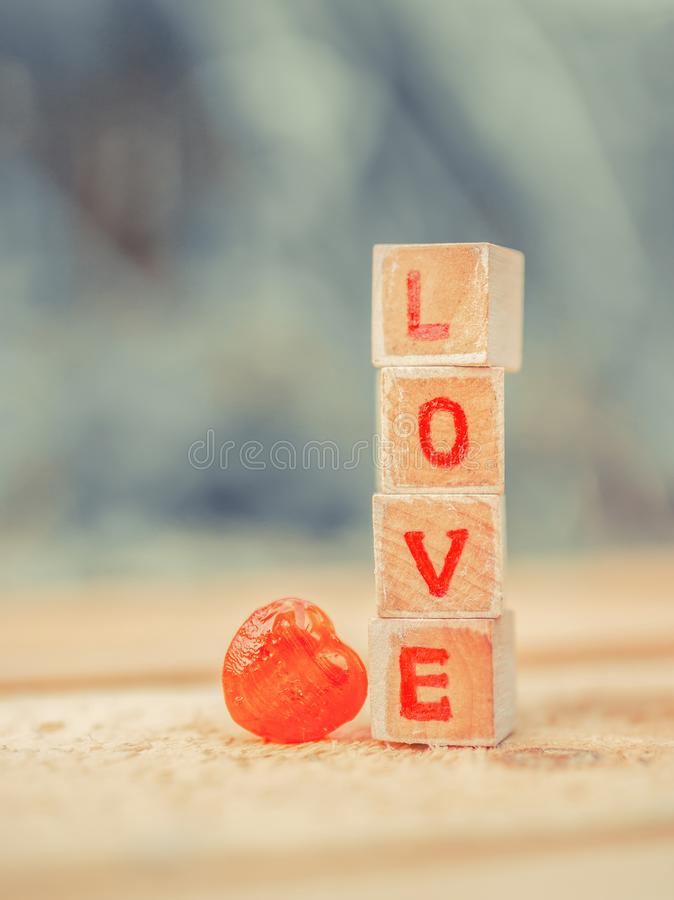 Love message written in wooden blocks. stock images