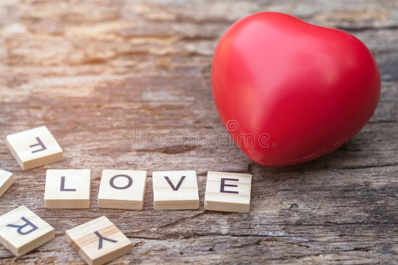 Love message written in wooden blocks. Red heart. stock images