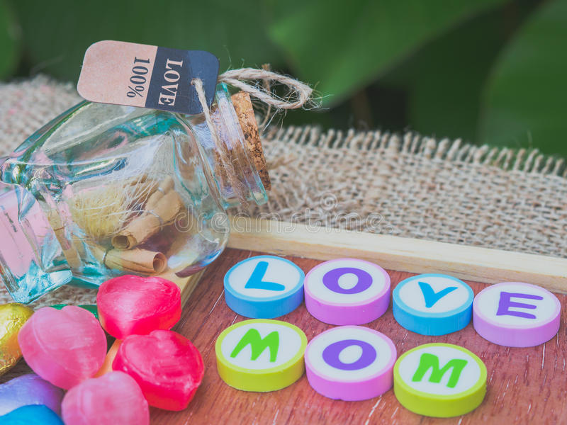 Love mom spelled with colorful alphabet blocks stock photos