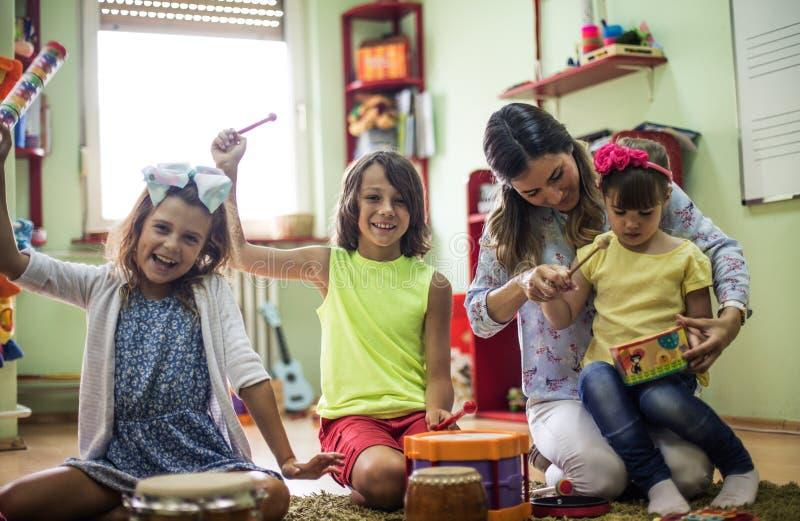 We love music. Children in preschool stock photo