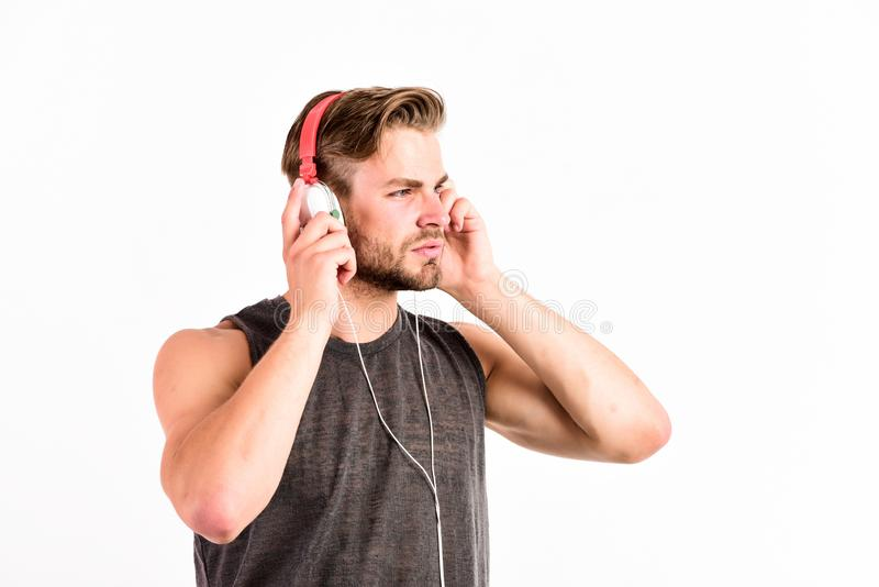 Love this music. new technology in modern life. sexy muscular man listen music. man listen new song isolated on white. Unshaven man in blue tooth technology royalty free stock image