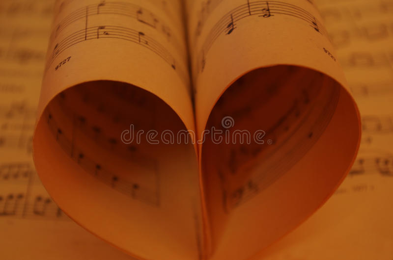 The love of music. Sheets of notes stacked in the shape of a heart stock photo