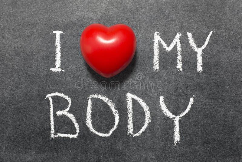 Love my body. I love my body phrase handwritten on school blackboard royalty free stock images