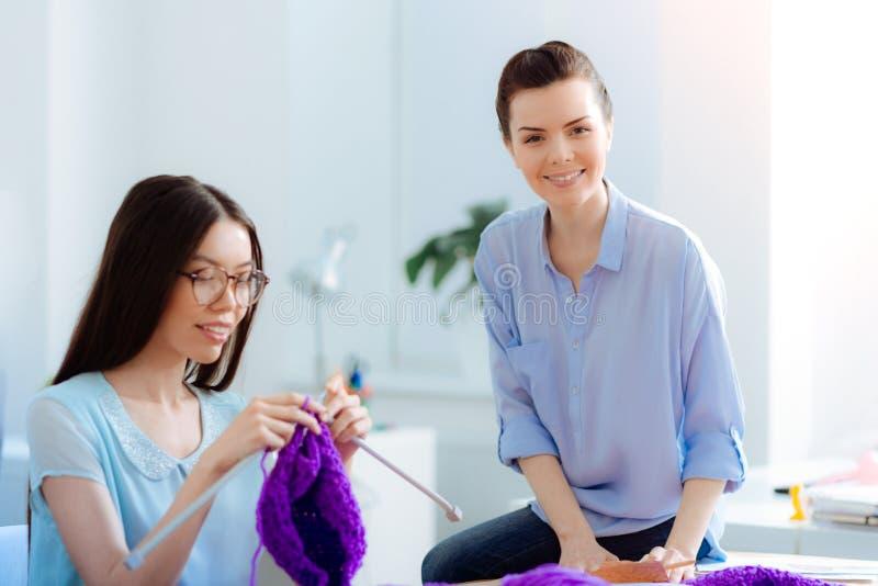 Young brunette girl using knitting needle royalty free stock image