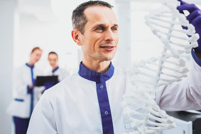 Portrait of delighted worker that wearing medical uniform royalty free stock image