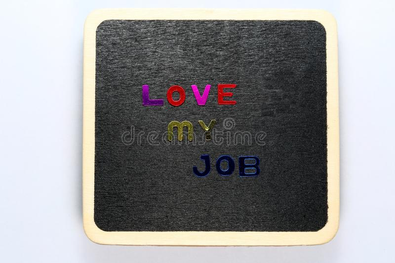 Love my job. Text of Love my Job on mini wooden blackboard stock photography