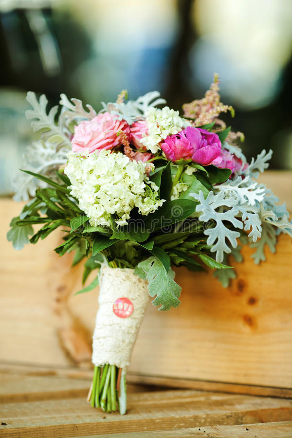 Love of my life. Wedding bouquet of flowers on a wooden background. stock image