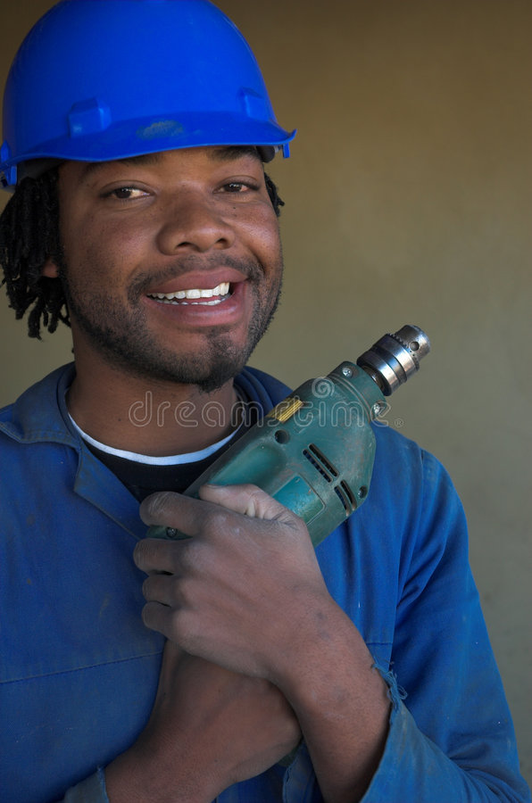 Love my power tool. Construction worker hugs his power tool drill royalty free stock images