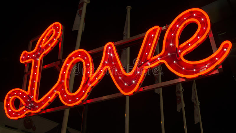 Love neon display. A red colored neon display of the word love. Photo taken on: August 17th, 2013 stock images