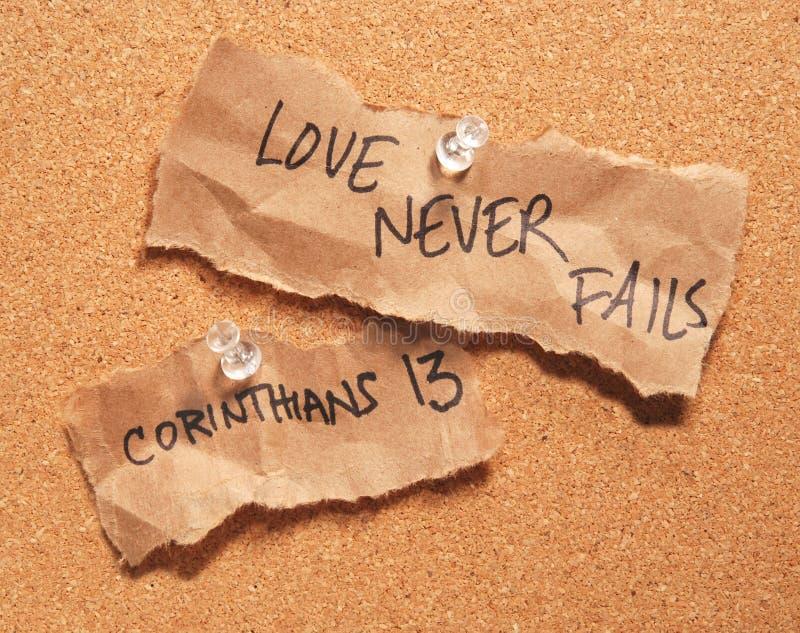 Love never fails. Corinthians 13, love never fails, pinned to a corkboard stock photo
