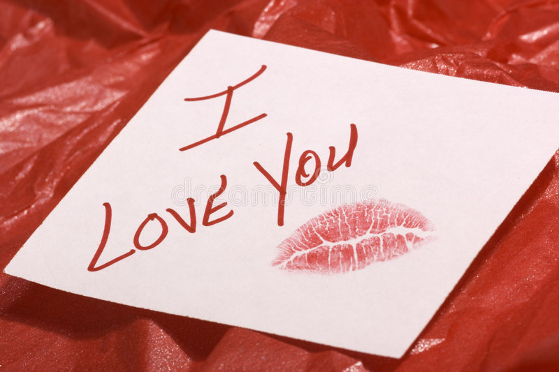 Download Love note on red gift wrap stock photo. Image of lipstick - 7480324