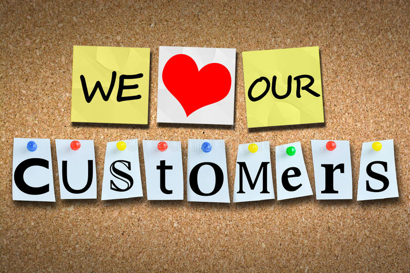 We love our customers on wooden cork billboard with colored pins stock images