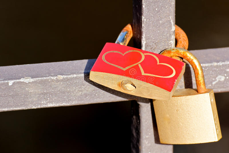 Love Padlocks at a Bridge. Love Padlocks or Love Locks, a modern symbol of lov and marriage, attached to a bridge royalty free stock image