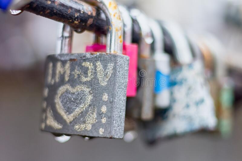 Love padlocks with drops of rain royalty free stock images