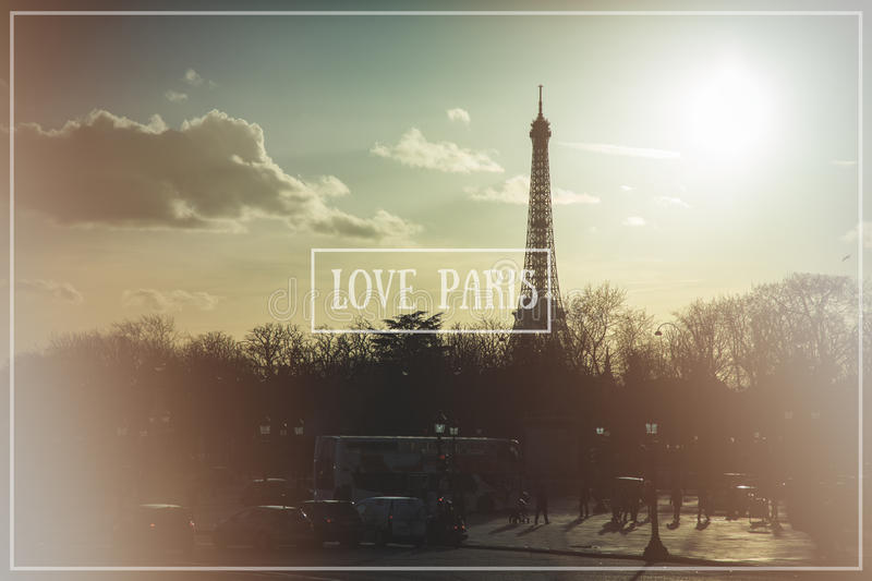 Love Paris. Paris cityscape with The Eiffel Tower at dusk, cross processed to look like an instragram style image, with light leaks and Love Paris banner stock photography