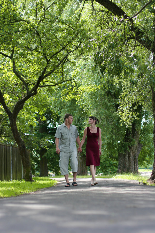 Love in park. Loving couple walking in park royalty free stock images