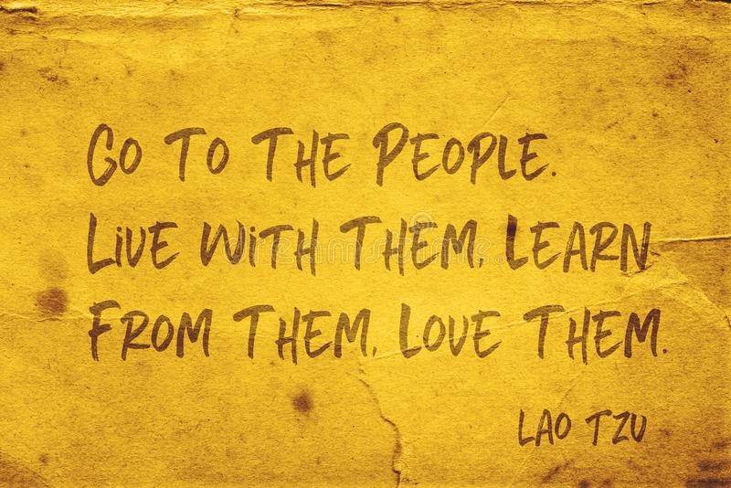Love people Lao Tzu. Go to the people. Live with them, learn from them, love them - ancient Chinese philosopher Lao Tzu quote printed on grunge yellow paper royalty free illustration