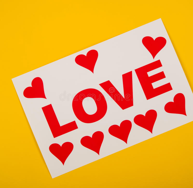 Love. Photo with hearts valentine love lies on a yellow background royalty free stock photos