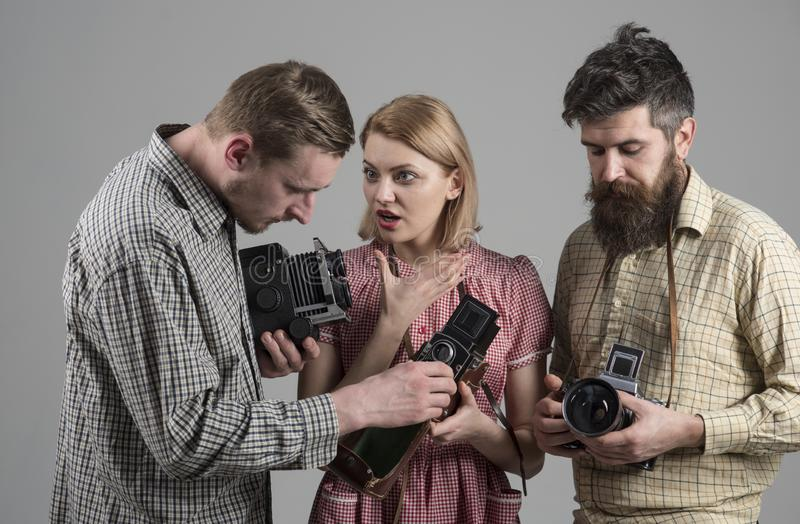 We love photo news. Paparazzi or photojournalists with vintage old cameras. Photography studio. Retro style woman and. We love photo news. Paparazzi or stock image