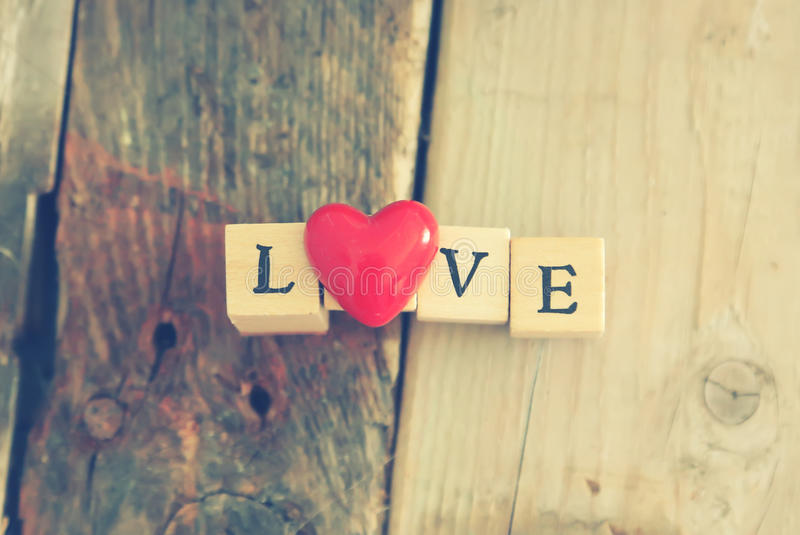 Love. Photo of wooden block with word LOVE stock photography