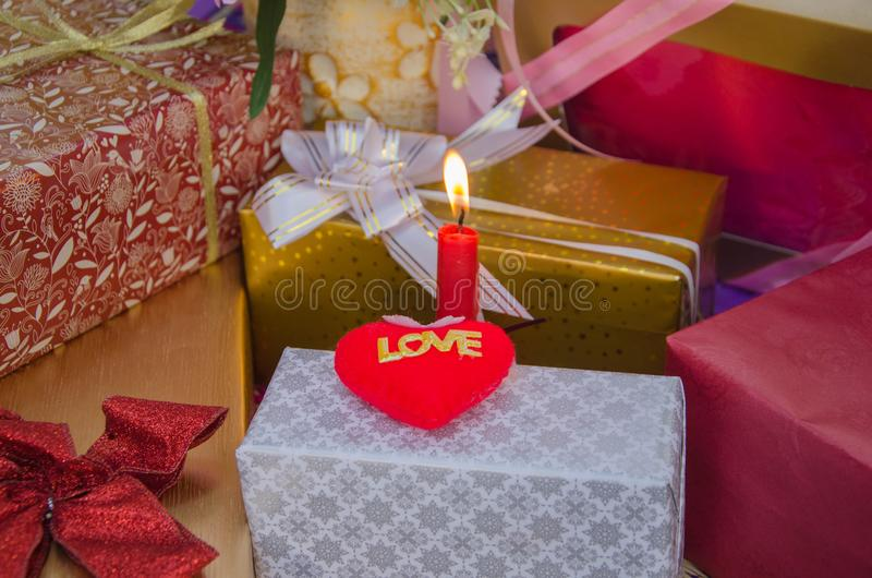 Love heart and present boxes in candle light stock image