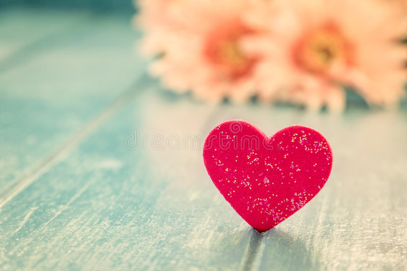 Love red heart. On blue wooden table background stock images