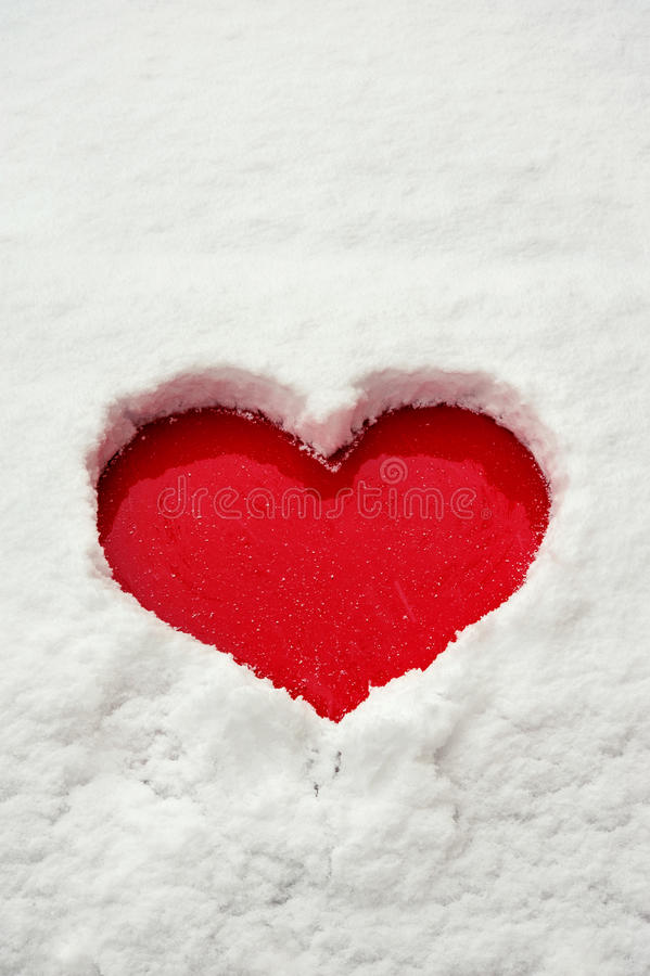 Love Red Heart Shape In Snow On Red Car. Close-up. Stock Photo