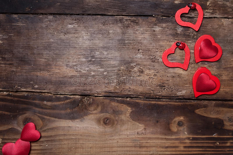 Love. Red hearts on the wood board royalty free stock photography