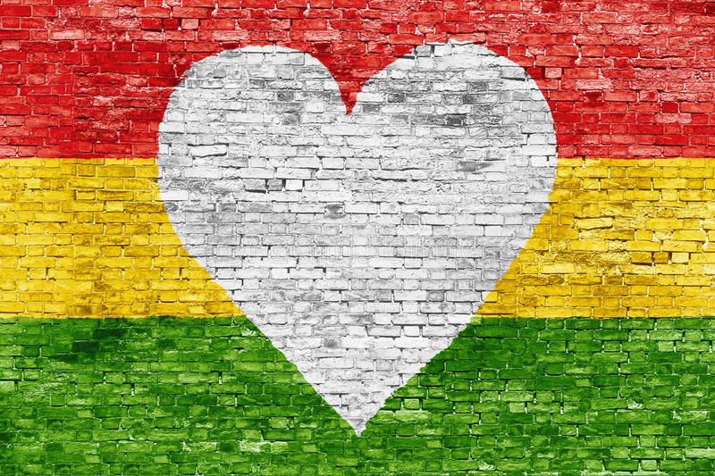Love for reggae. Music loving painted over white brick wall royalty free stock images