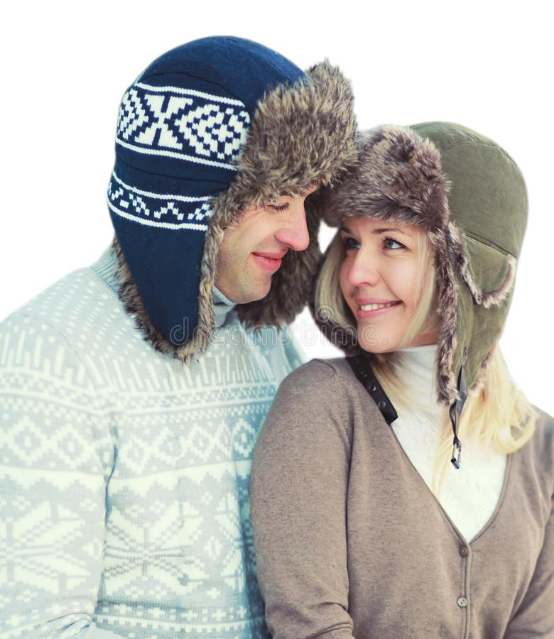 Love, relationship and people concept - portrait of happy smiling couple in pullover and winter hat isolated on white royalty free stock photography