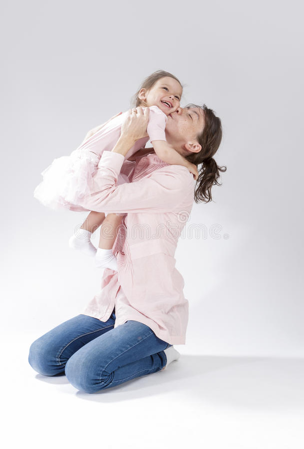Love and Relationships Concepts. Portrait of Young Mother Kissing Her Child stock image
