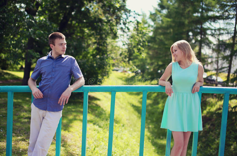 Love, relationships, dating - concept, pretty couple looking. At each other on the street royalty free stock photo