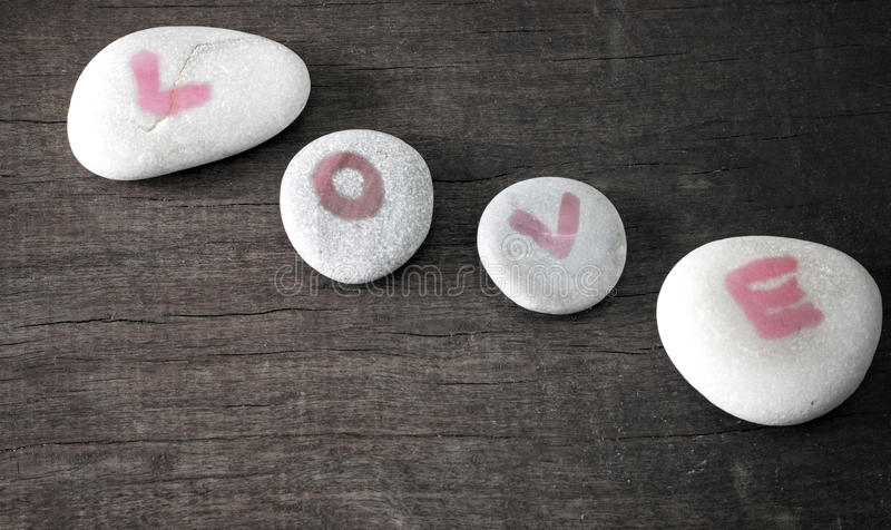 Love on rocks stock photos