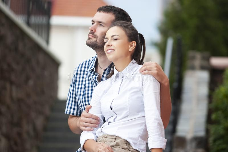 Love, Romance and Care Concepts. Closeup Portrait of Young Caucasian Couple Traveling Around City. Posing Embraced Together stock photos