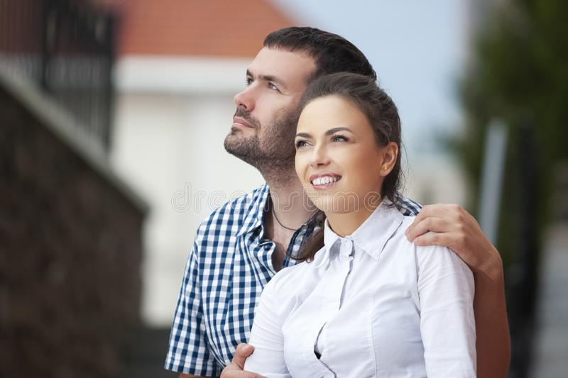 Love, Romance and Care Concepts. Closeup Portrait of Young Caucasian Couple Traveling Around City. Posing Embraced Together stock photo